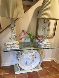 Art Nouveau style glass top console table with lady head in relief, pair of blanc de chine water lily motif lamps