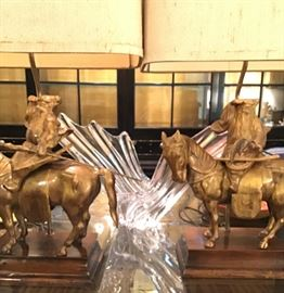 A pair of Asian gilt metal statues of warriors on horseback mounted as lamps