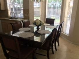 Rectangular wood table with 6 chairs and glass table top