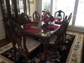 Formal wood dining table & 6 chairs with cream fabric seats.  Glass table top is included.   Lightly used.