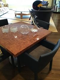 Modern burlwood table with metal base, blue leather chairs, Murano dolphin
