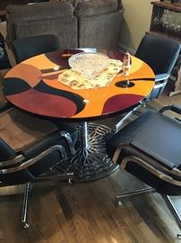 Modern handmade inlaid top table, chrome base, four chrome and leather swivel dining chairs