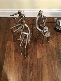 Three metal sculptures of musicians