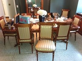 Italian Lacquer dinning room table with 12 chairs. satin material on chairs.
