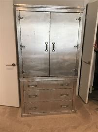 Extra cool metal clad on wood armoire. 4 shelves and 3 drawers.  $875