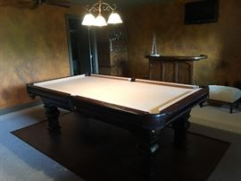 Like-new Spencer &  Marston pool table, including cue sticks and other accessories