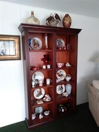 Wood book shelf with collector plates.