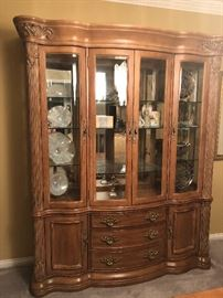 Bernhardt China Buffet/Cabinet with 3 glass shelves , 3 interior Recess lights, and mirror backing. 3 drawers total. Top drawer is lined in velvet with dividers for Flatware. 2 Side cabinets with 1 shelf. Approximately 68 inches wide, Height  89 inches, & Depth 16 3/4 inches. Items inside Not Included!