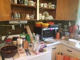 microwave, miscellaneous glassware, kitchen utensils