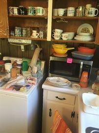 microwave, dryer, coffee mugs