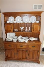 Maple hutch shown with milk glass and china.