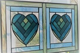 Blue stained glass horizontal hearts