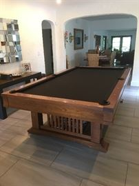 Brunswick Professional Pool Table - This is a top-of-the-line professional-length (9') pool table / billiards table constructed of sold oak. The style is simple, not too modern/contemporary. Can complement any architectural style home. Perfect condition, but recommend replacing felt when setting it up in your home. $5,500
