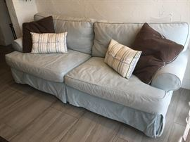 """Jennifer Convertibles Sleeper Sofa - Incredibly comfortable sleeper/pullout couch with seafoam-blue cotton twill slip cover and chocolate-brown pillows. Measures 92"""" in length. This is a top-of-the-line piece that will last a lifetime. $600."""
