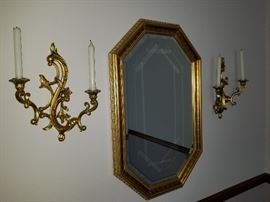 Octagonal mirror and wall sconces