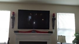 FLAT SCREEN, CANDLES AND FLAG