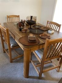 Solid wood dining table with upholstered chairs