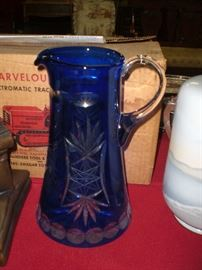 blue cased cut to clear glass water pitcher