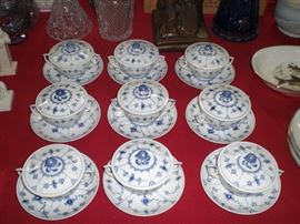 Royal Copenhagen cream soups with lids and underplates in the blue onion pattern