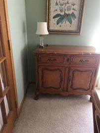 Antique china cabinet to store dishes and glassware.  Matches table.  75 yrs. old.  In great condition.