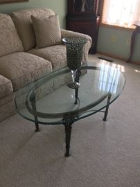 Glass cocktail table with metal base.  Great condition.