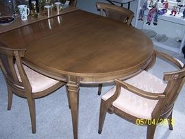 Metz made dining room table  (64 in. x 44 in.) , 2 Captain's chairs, 4 chairs, 2 - 15 in. leaves and pads