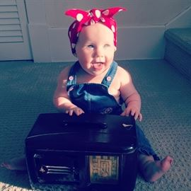 Please note, the baby aka Rosey the Riveter, is not for sale, just the Bakelite Radio.