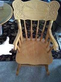 Child's rocker. Antique, mint, pressed back. 40.00 firm.purchased in an antique store.