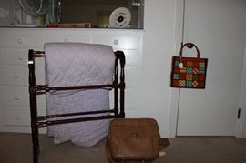 Old handmade quilt, quilt stand and needlepoint bag