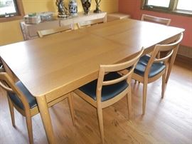 Table has 8 Chairs and 1 leaf inside