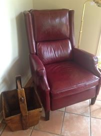 Good-looking burgundy leather recliner; antique wooden rice bucket