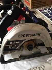 Craftman 2 1/8 saw; many other tools in the 3-car garage