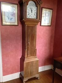 "A ""striking"" grandfather clock is in the entry of the home."