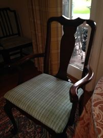 One of two armed dining chairs