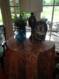 The custom-made table skirt & glass top make a beautiful table.
