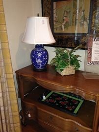 Two tier cart; blue & white Asian style lamp; above - Asian framed art.