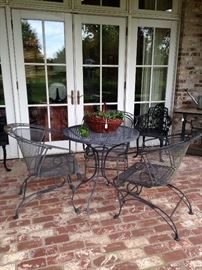 Small black patio table and 3 spring chairs