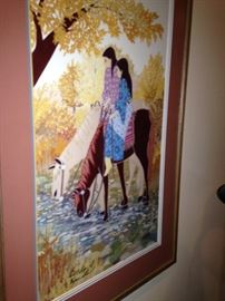 Lady and child on horseback framed art