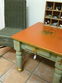 Pale green wicker chair; green, gold, and orange side table