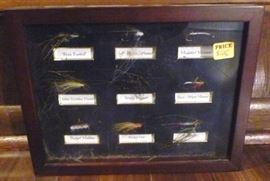 "Framed shadowbox of fishing flies, 8.5"" L X 11"" W"