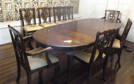 "Solid wood dining table with 8 Chippendale style  needlepoint chairs and three leaves, 64"" L  (without leaves) x 44"" W, 30"" H (leaves are 18""  L), Chair 24"" W x 18"" D, 38"" H"