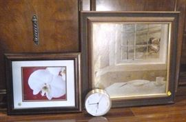 "Two framed prints, 1 floral, 1 still life, and a  wall clock, Bigger frame is 23"" L X 22"" W"