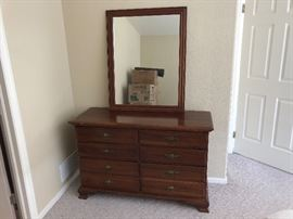 60 year old dresser and matching mirror. Great for a second home bedroom or starter furniture for a college grad!
