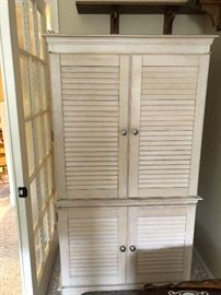 Armoire that will hold a TV and/or clothing, bedding, pillows. Distressed wood is a good look in almost any room.