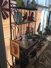 Two wrought iron baker racks/outdoor plant stands
