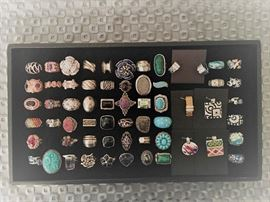 A variety of sterling silver rings with a variety of stones including cubic zirconia, druzy quartz, onyx, amethyst, turquoise and more. The sterling silver enamel and cubic zirconia pieces on the right side are designer Belle Etoile. All 50% off!