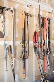 Various Sets Of Skis Including Salomon And Elan