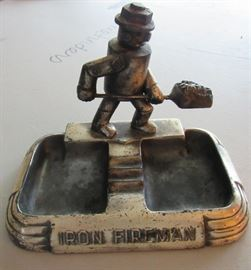 Iron Fireman Company of Cleveland, Metal Ash Trays with Shoveling Man (2 available)