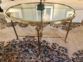 Polished solid brass oval cocktail table by La Barge