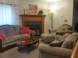 Matching sofa, loveseat, chair and ottoman.  Oval cherry coffee table.